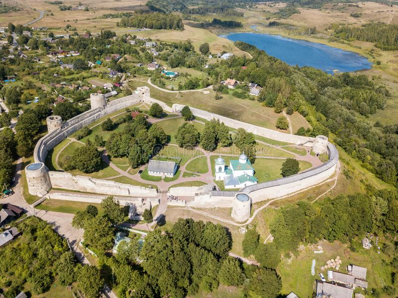 Izborsk medieval Russian fortress kremlin with a church. Aerial drone photo. Near Pskov, Russia. Birds eye view.  royalty free stock photography