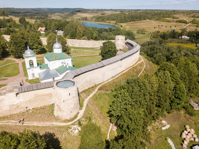 Izborsk medieval Russian fortress kremlin with a church. Aerial drone photo. Near Pskov, Russia. Birds eye view.  royalty free stock image