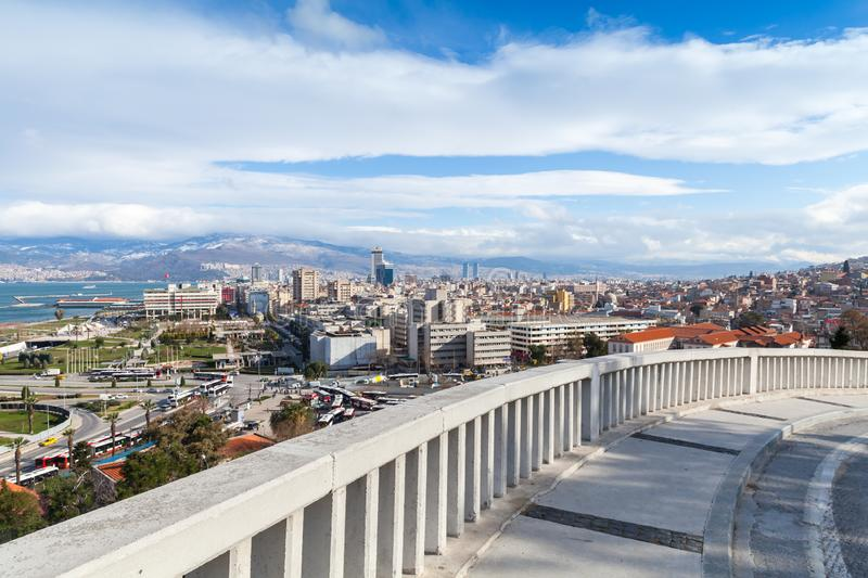 Izmir, Turkey. Cityscape with modern buildings. And mountains under cloudy sky stock photo