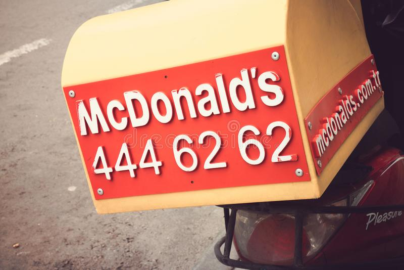 Izmir, Turkey - 19 May 2019: Close up shot of the McDonald`s tail box delivery motorcycle or motorbike with the call center royalty free stock images