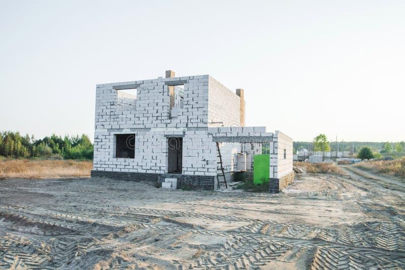 IZOBLOK BUILDING SYSTEM. Construction of the Unfinished house. IZOBLOK BUILDING SYSTEM. Construction of the Unfinished white brick house stock image
