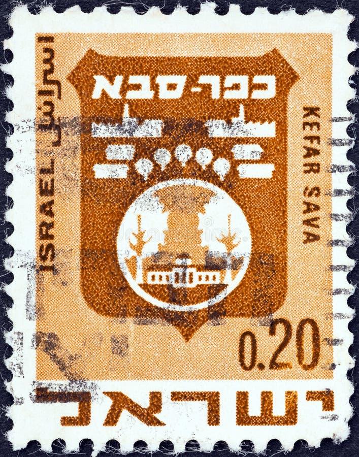 IZRAEL - CIRCA 1969: Pieczęć wydrukowana w Izraelu pokazuje herb Kefar Savy, okoÅ'o 1969 roku zdjęcie stock