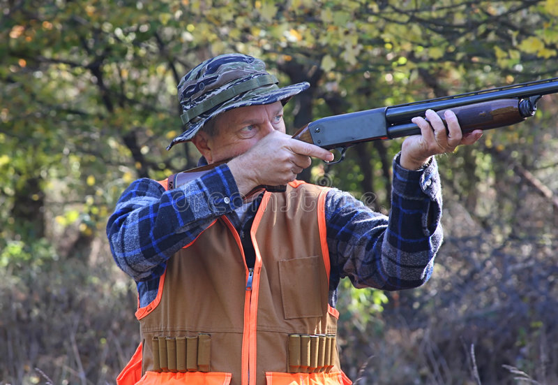 Jäger im Fall lizenzfreies stockbild