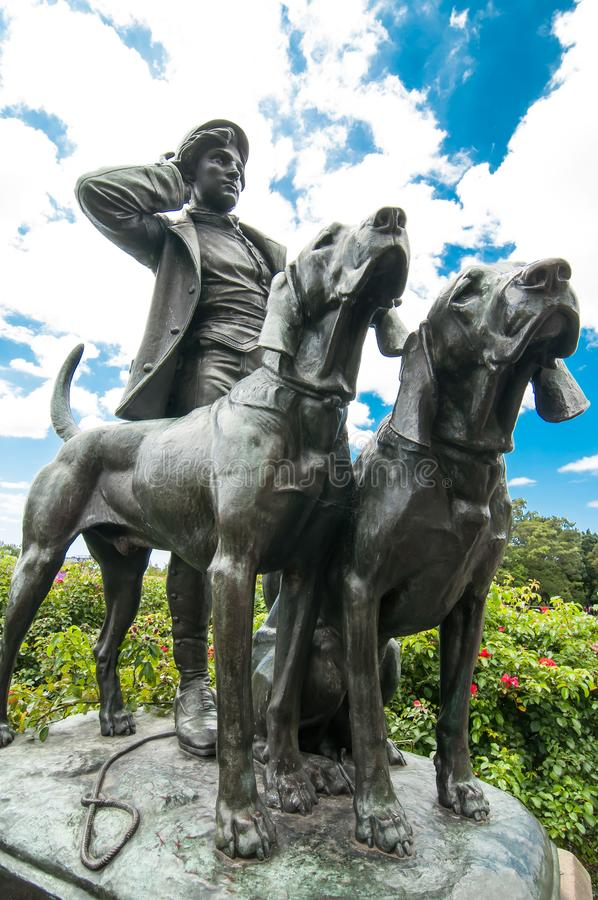 ` Jäger und Hunde` Statue am königlichen botanischen Garten, NSW lizenzfreie stockbilder