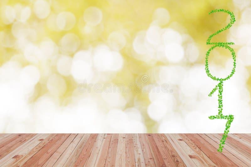 2017-jähriges gemacht von den grünen Blättern mit Perspektivenholzfußboden lizenzfreie stockbilder