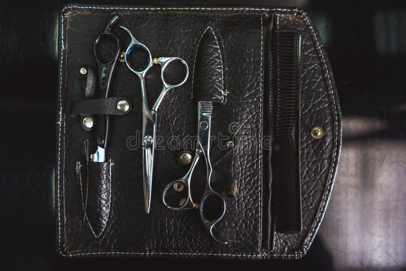 Järnhjälpmedel för frisörarbete royaltyfri bild