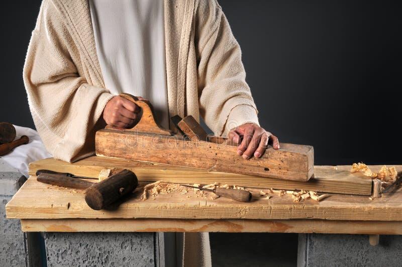 Jésus avec l'avion en bois images stock