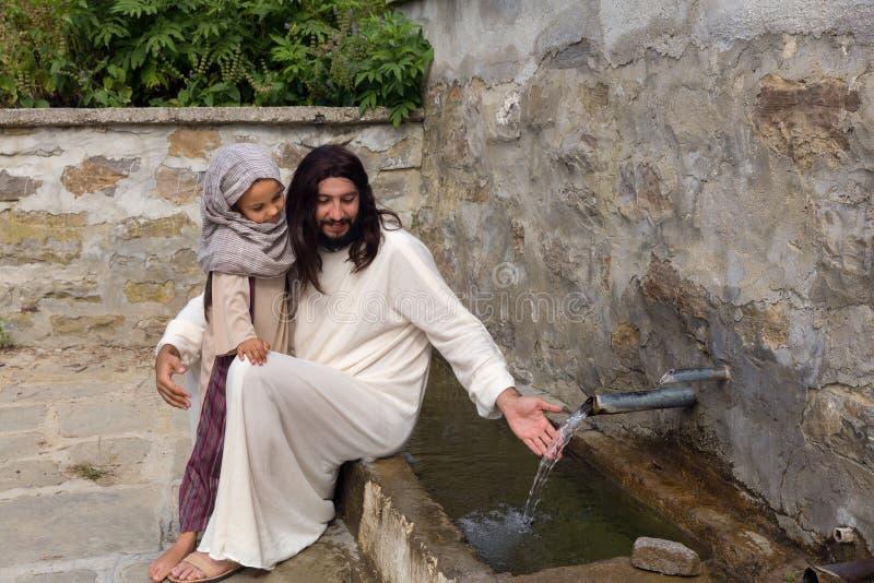 Jésus avec une fille à un puits d'eau image stock