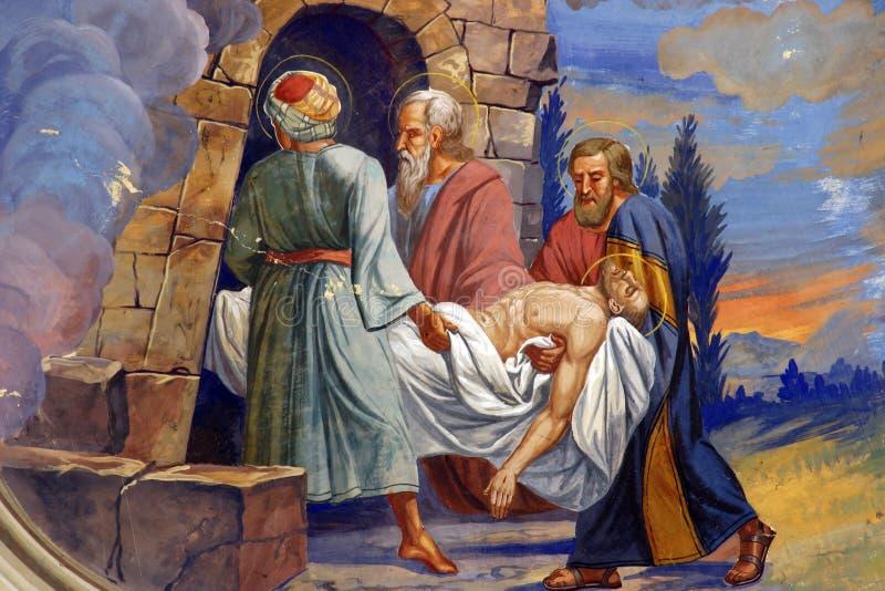 Jésus est étendu dans le tombeau photo stock