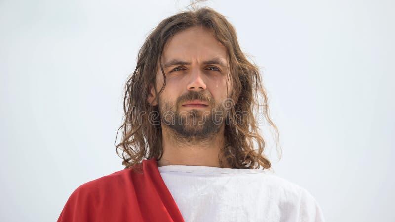 Jésus pleure et regarde la caméra, ressent de la compassion pour les gens, de la miséricorde photographie stock libre de droits