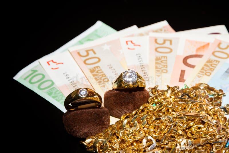 Dinheiro e jóias foto de stock