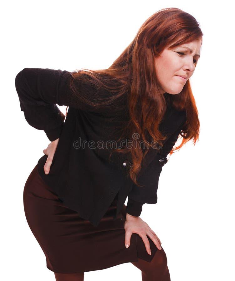 Jóvenes más bajos b de la muchacha del osteochondrosis del dolor de lesión femenina trasera de la mujer fotos de archivo libres de regalías