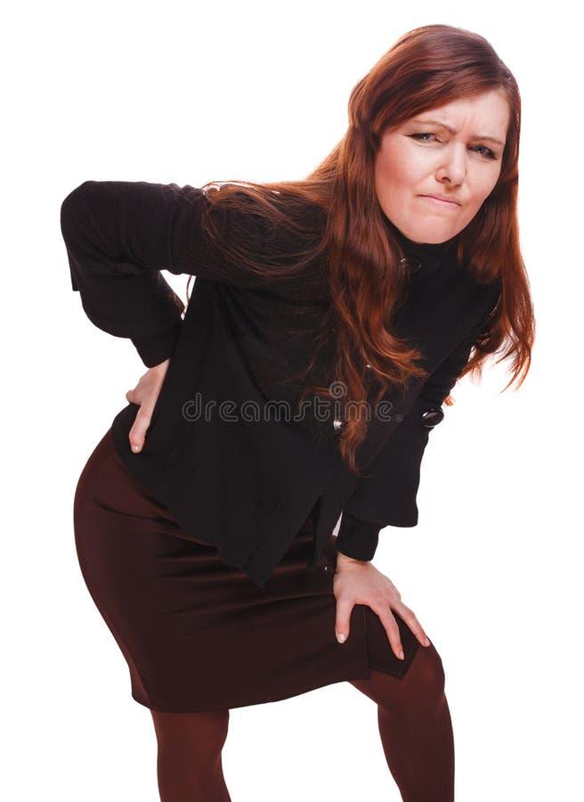 Jóvenes más bajos b del osteochondrosis de la muchacha del dolor de lesión femenina trasera de la mujer fotografía de archivo