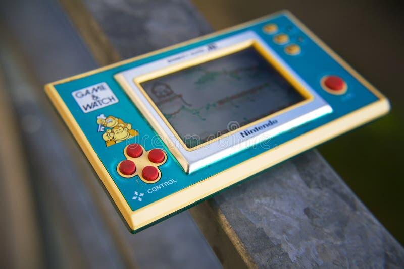 JÚNIOR eletrônico handheld de Kong do asno do jogo de Nintendo do vintage fotos de stock royalty free