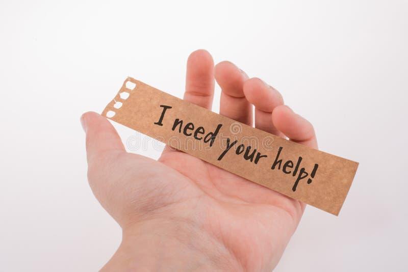 J'ai besoin de votre aide exprimant sur le papier à disposition photographie stock
