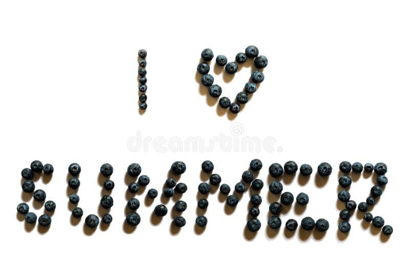 J'aime la phrase d'été faite de myrtilles images libres de droits
