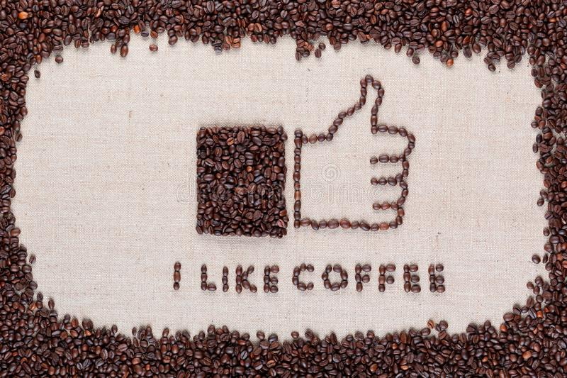 J'aime le café avec le bouton similaire entouré par des grains de café sur la toile de toile image libre de droits