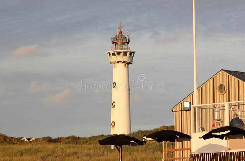 Lighthouse at sunset in the twilight. Egmond aan Zee, North Sea, the Netherlands. royalty free stock photos
