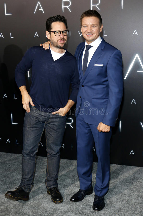 J.J. Abrams and Jeremy Renner. At the Los Angeles premiere of 'Arrival' held at the Regency Village Theater in Westwood, USA on November 6, 2016 royalty free stock image