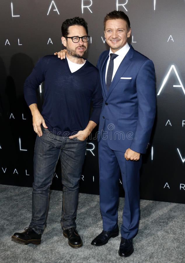 J.J. Abrams and Jeremy Renner. At the Los Angeles premiere of `Arrival` held at the Regency Village Theater in Westwood, USA on November 6, 2016 royalty free stock photos