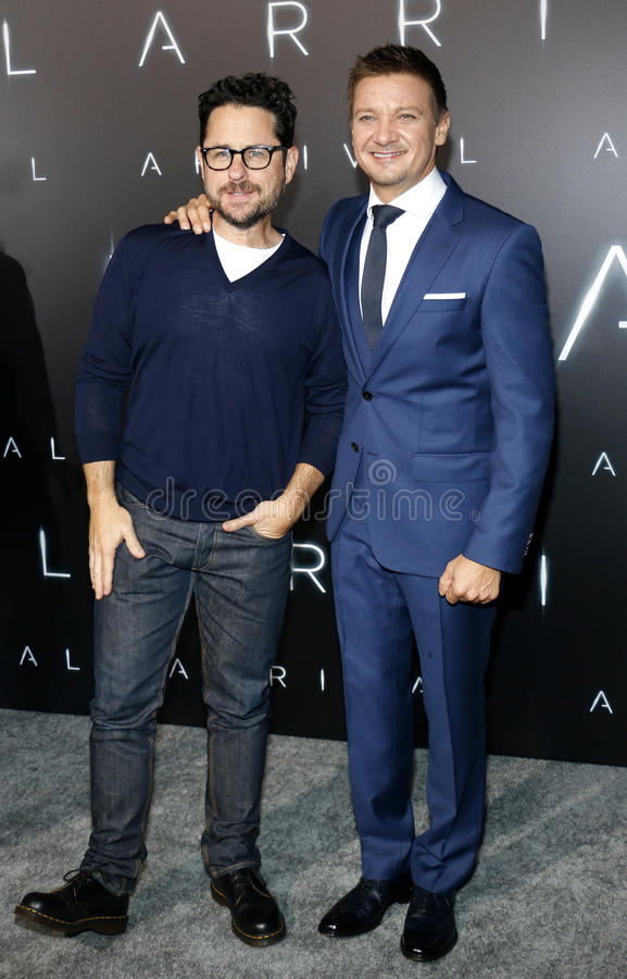 J.J. Abrams and Jeremy Renner. At the Los Angeles premiere of `Arrival` held at the Regency Village Theater in Westwood, USA on November 6, 2016 royalty free stock photo
