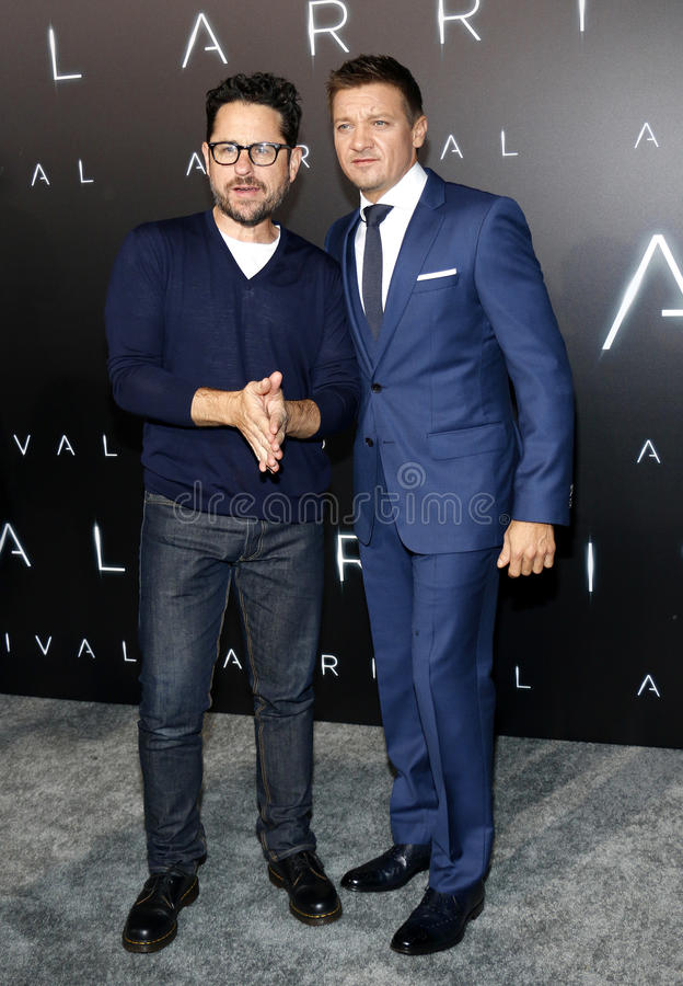 J.J. Abrams and Jeremy Renner. At the Los Angeles premiere of 'Arrival' held at the Regency Village Theater in Westwood, USA on November 6, 2016 stock photo