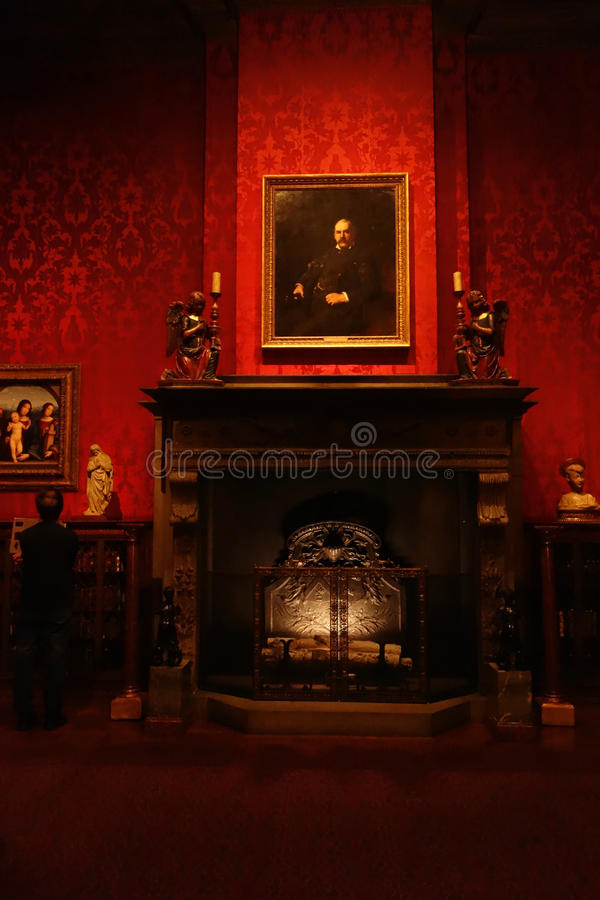 J.P. Morgans Study. The study of American financier J.P. Morgan at The Morgan Library & Museum, in New York City. Above the mantle is a portrait of the banker royalty free stock image