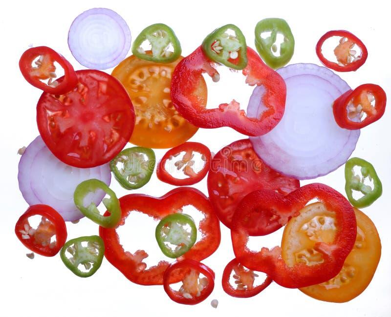 jaśnieje cebuli pieprzu plasterki pomidorowych fotografia stock