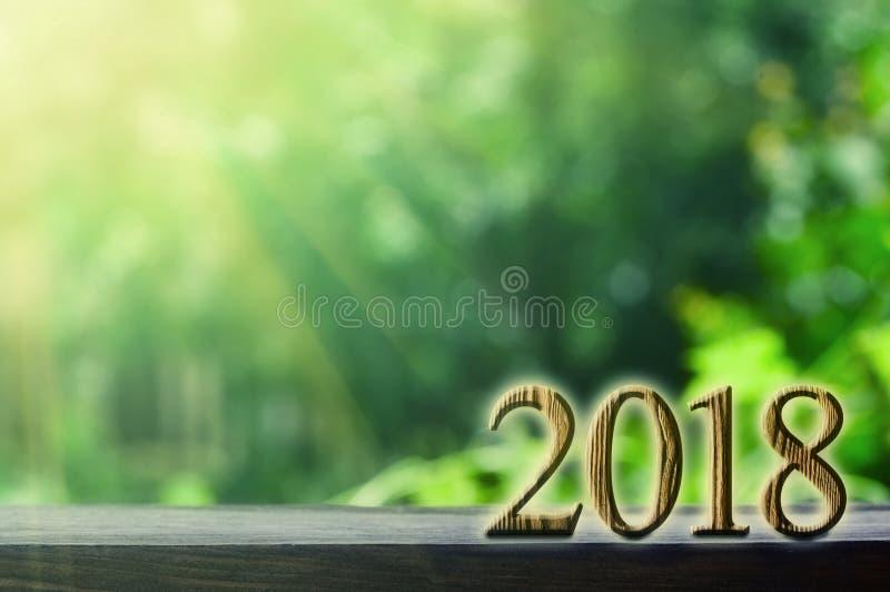 jaar op de groene achtergronden stock foto's
