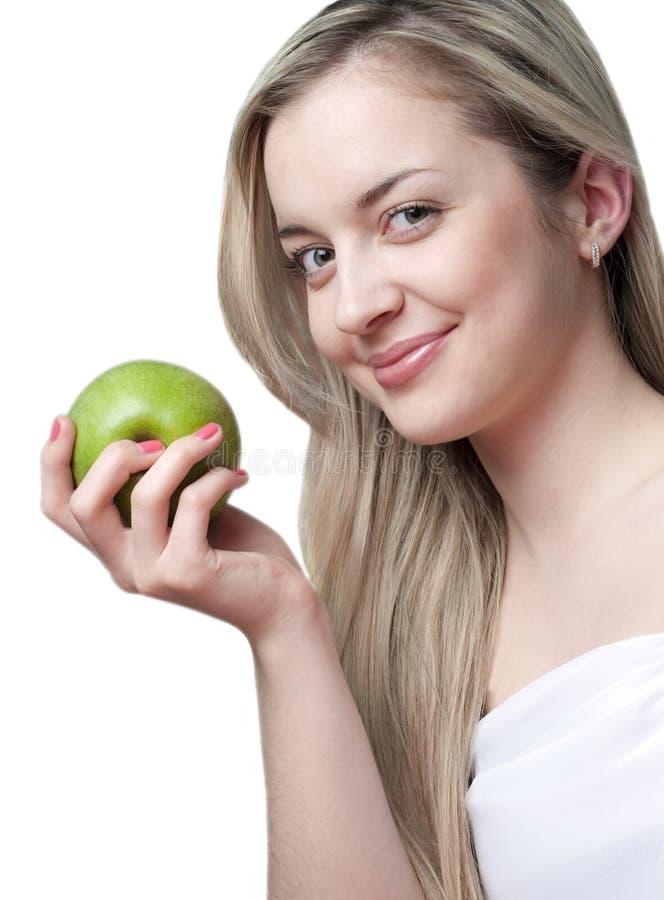 jabłczana piękna blond uśmiechnięta kobieta obrazy royalty free