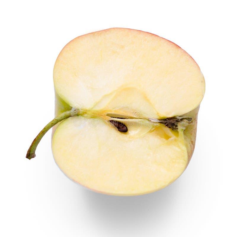 Jabłczana połówka na białym tła odosobnieniu zdjęcie stock