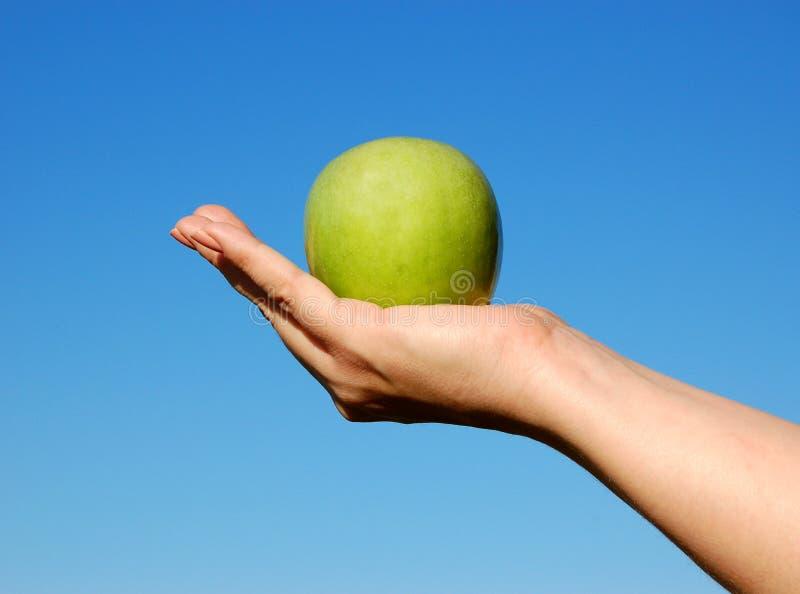 jabłczana ręka zdjęcia royalty free