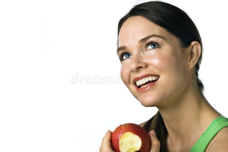 jabłczanego pięknego łasowania szczęśliwi kobiety potomstwa zdjęcia stock
