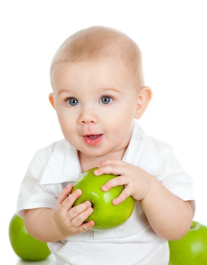 jabłczany chłopiec łasowania zieleni mienie fotografia royalty free