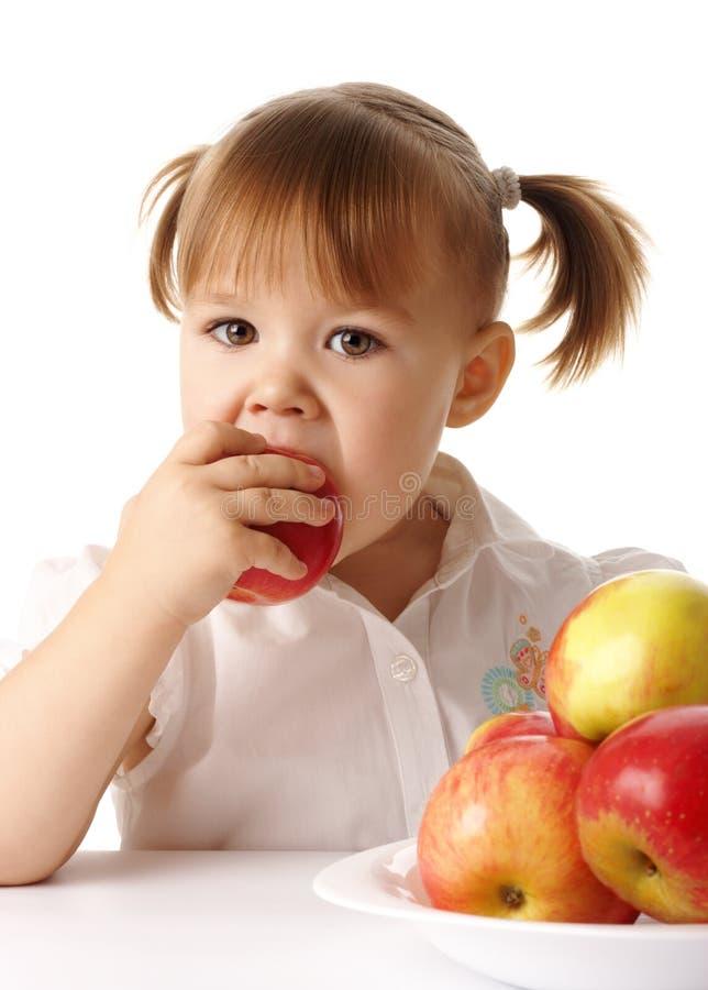 jabłczany dziecko je czerwień fotografia royalty free