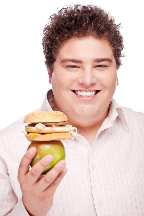 jabłczany pyzaty hamburgeru mienia mężczyzna obraz royalty free