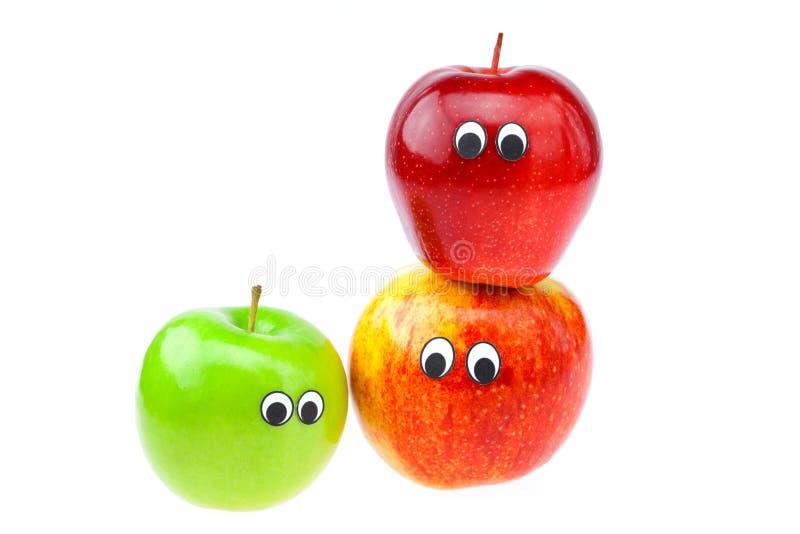 jabłek oczu twarze odizolowywali biel obraz stock