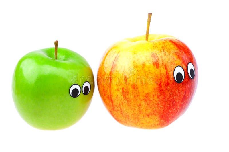 jabłek oczu twarze odizolowywali biel fotografia royalty free