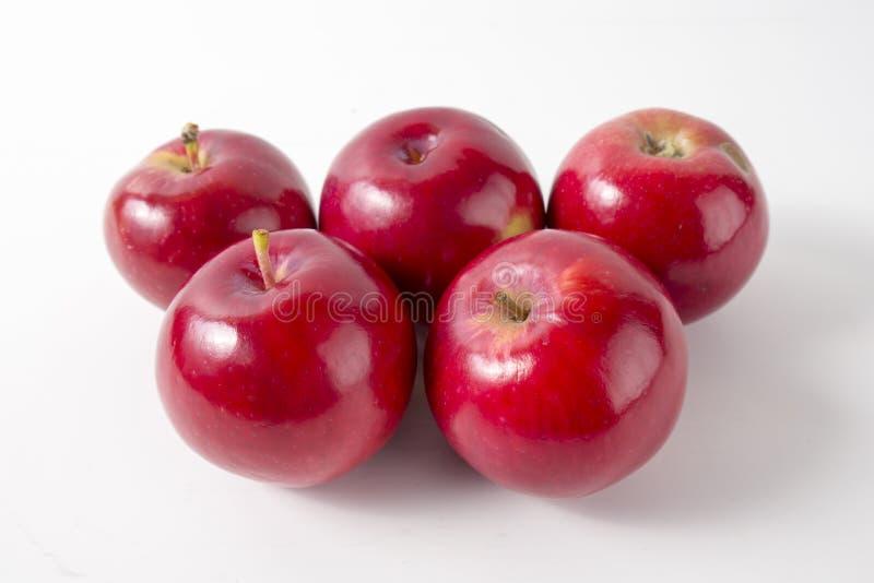 jabłek tła czerwony biel wierzchołek zdjęcia stock