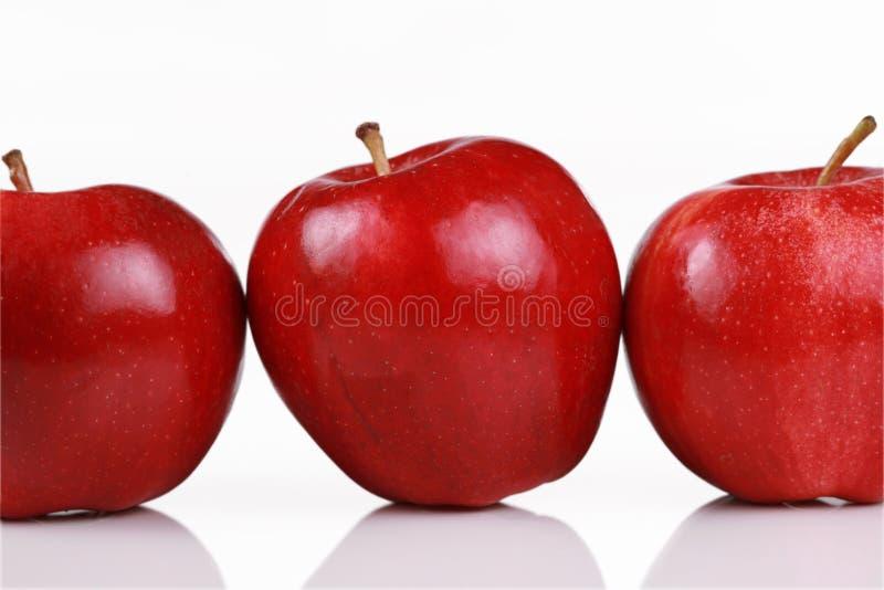 jabłka czerwoni błyszczący trzy obrazy royalty free