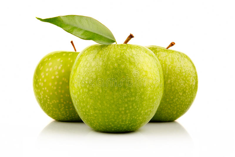 jabłka zielenieją dojrzałego biel trzy zdjęcia stock