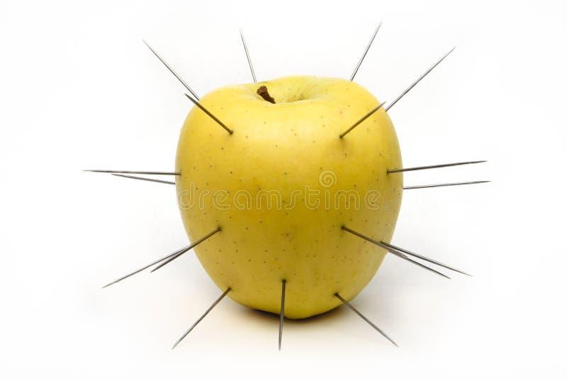 jabłko gwożdżący biel fotografia stock