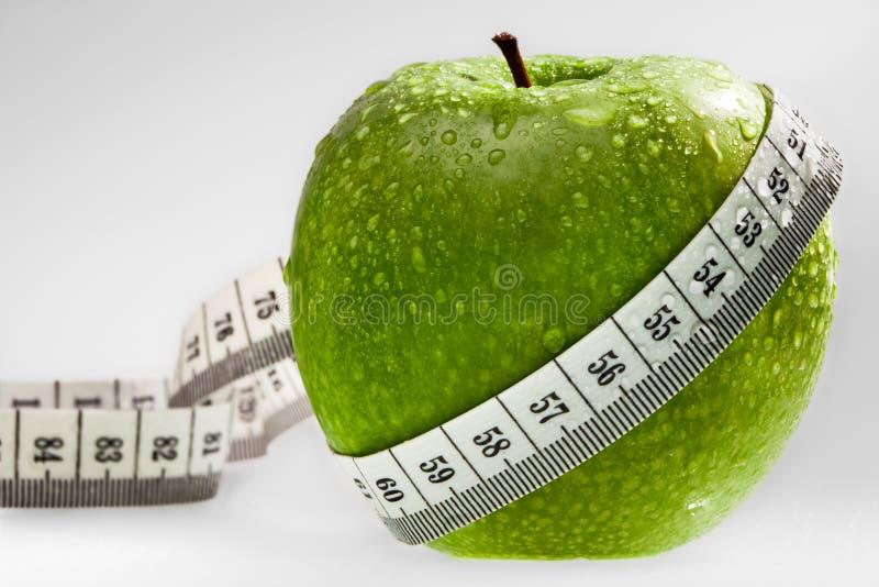 jabłko jako pojęcia diety zieleń zdrowa obrazy stock