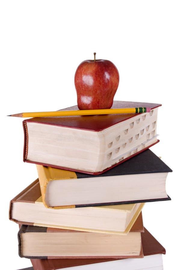 jabłko sterta książkowa ołówkowa fotografia stock