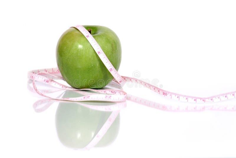 jabłko - zielona pomiar taśmy obraz stock