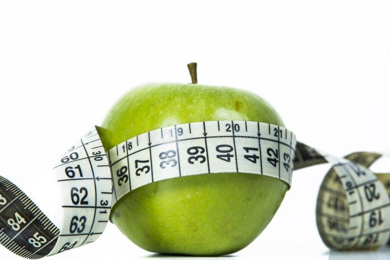 jabłko - zielona taśma pomiarowa zdjęcia royalty free