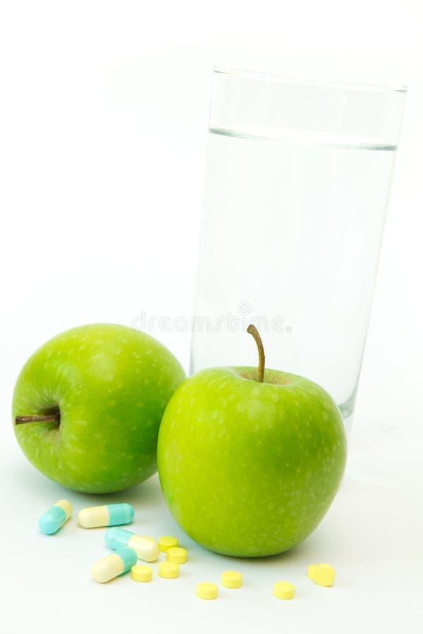 jabłko - zielony target3749_1_ pigułek fotografia stock