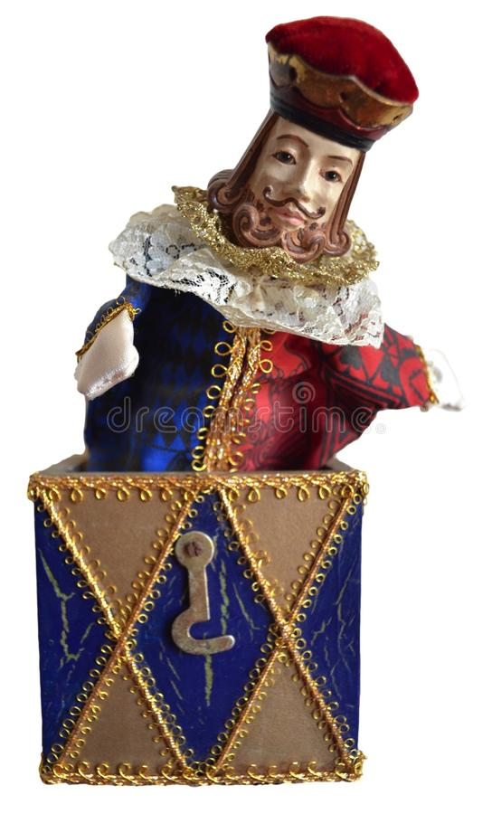 Jack in the box. A jack in the box isolated on a white background. A king inspired by a deck of cards springs out of the box royalty free stock image