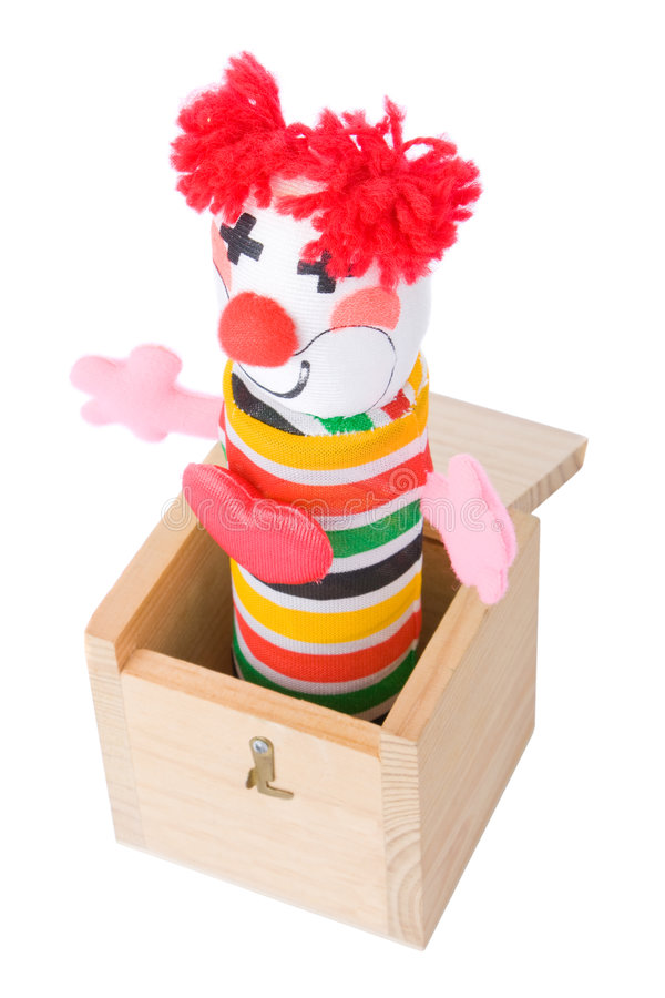 Jack-in-the-box toy. Isolated on a white background stock images