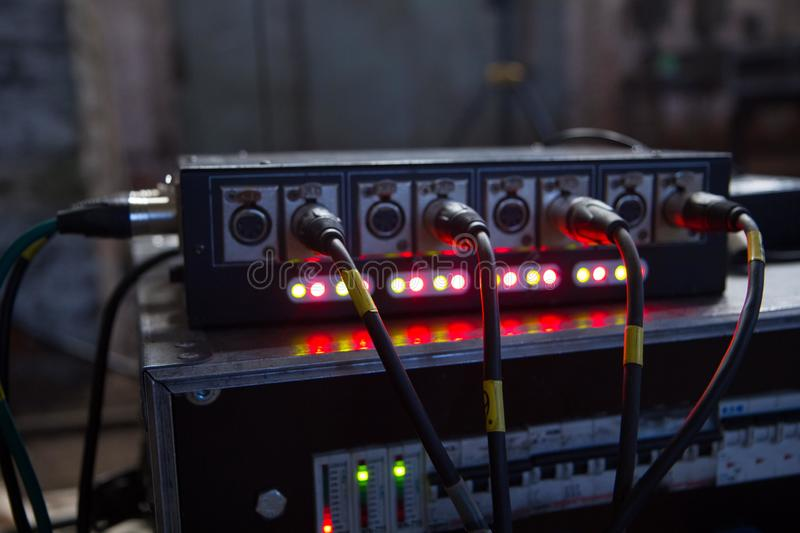 Jack and cable to the back of the light equipment. Jack and cable to the back of the light sound equipment stock image